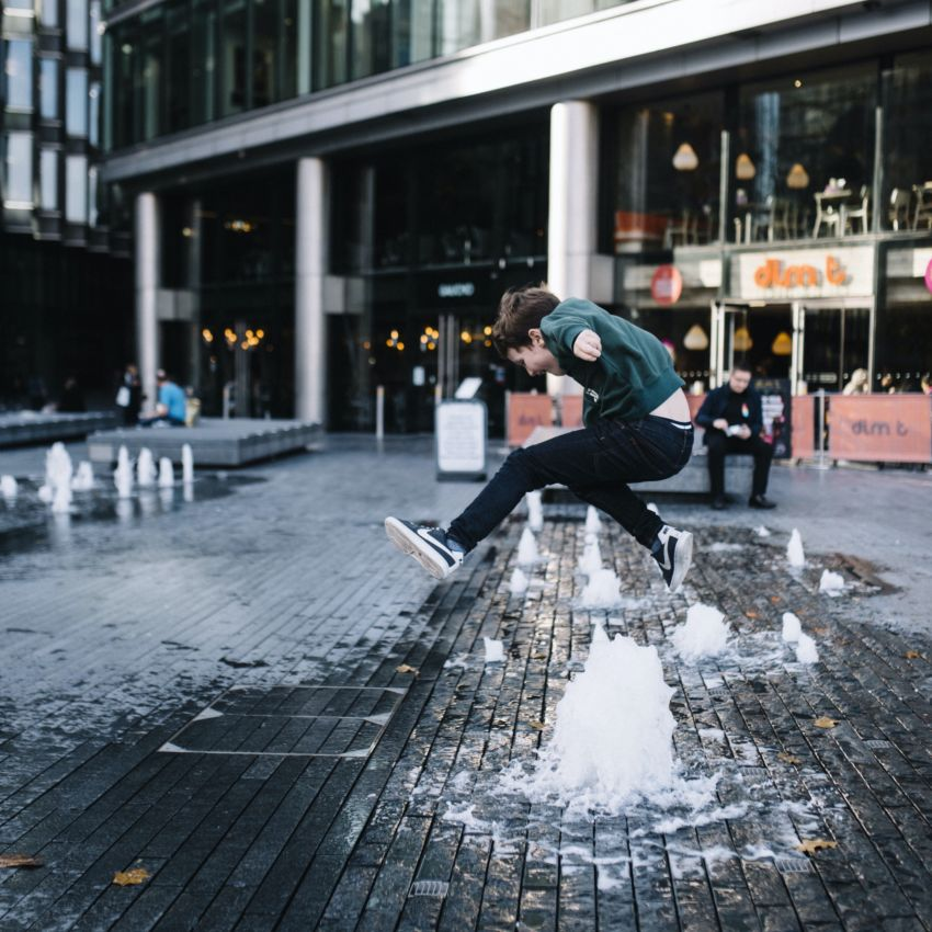 Child Jumping over Fountain at More London