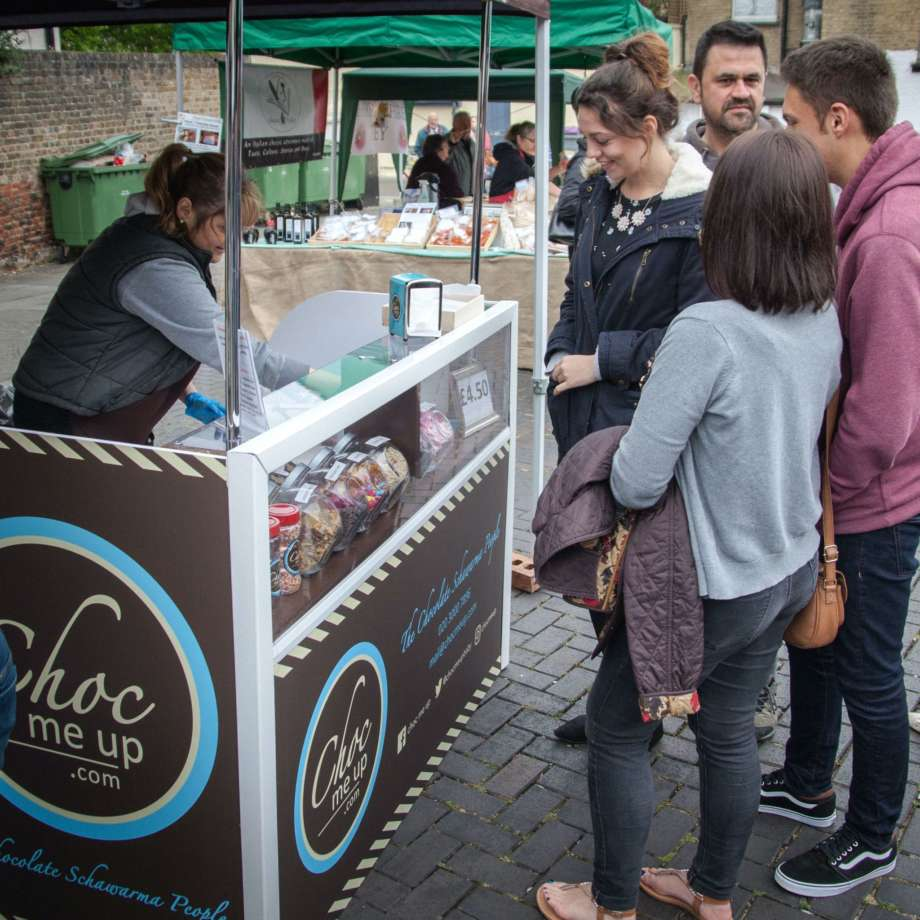 People queuing for pancakes from Choc Me Up Stand